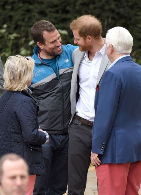Peter Phillips and Prince Harry, Duke of Sussex attend the