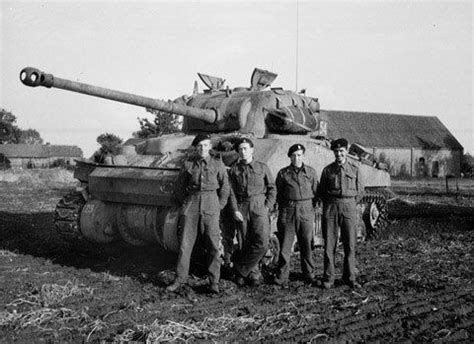 Members of the 7th Armoured Division with their Firefly in