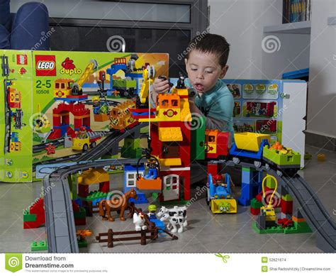 Toddler Boy Playing With LEGO Duplo Train And Farm