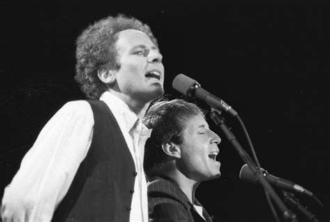 Simon and Garfunkel plays to a crowd in Central Park in
